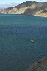 Вид с горы Васюкова на бухту Провато и лодку в море
